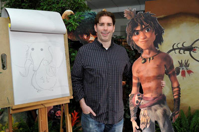 Animator Sean Sexton with Croods characters