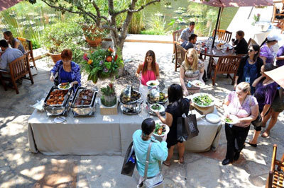 Reporters fed lunch by the Koi pond