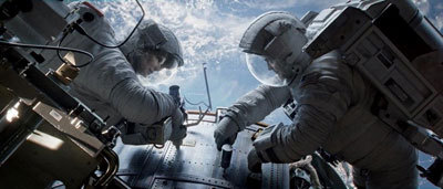 The astronauts work on the Hubble Space Telescope
