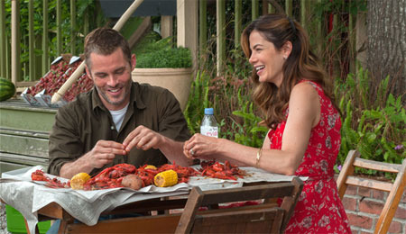 Older Amanda and Dawson share a Louisiana snack