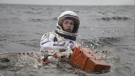 Amelia (Anne Hathaway) struggles after a water landing
