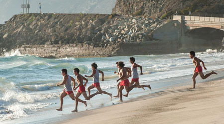 The team running into the ocean