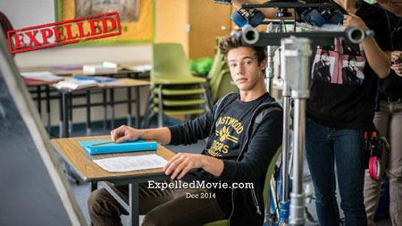 Cameron as Felix in a classroom during the shoot