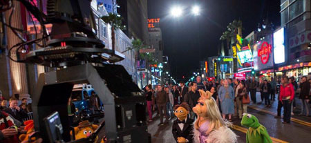 Miss Piggy, Walter and Kermit on set on Hollywood Blvd.