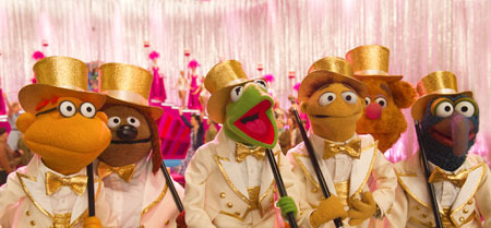 Muppets performing a big number on stage