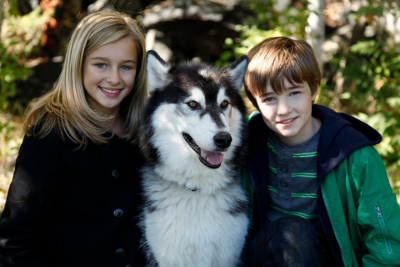 Erin and CJ with Houston, an Alaskan Malamute