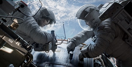 Astronauts Stone and Kowalski work on the Hubble Telescope