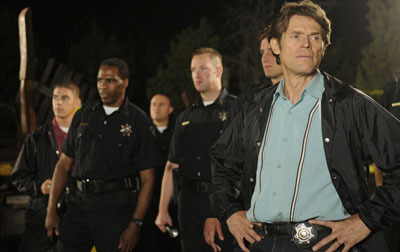 Good cop Porter (Willem Dafoe)
