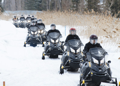 The team snowmobiling