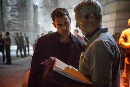 Theo James goes over the script with director Neil Burger
