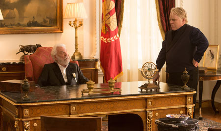 President Snow and gamemaker Heavensbee discuss rebellion
