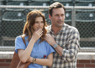 J.B. (Jon Hamm) and Brenda (Lake Bell) watch the boys play