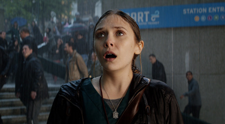 Elle (Elizabeth Olsen) finally sees Godzilla