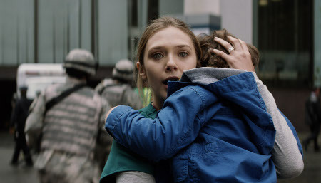 Elle (Elizabeth Olsen) and her son cower from the monsters