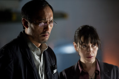 Scientists (Ken Watanabe and Sally Hawkins) worry about the monsters