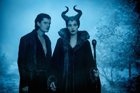 Maleficent (Angelina Jolie) with servant Diaval (Sam Riley)