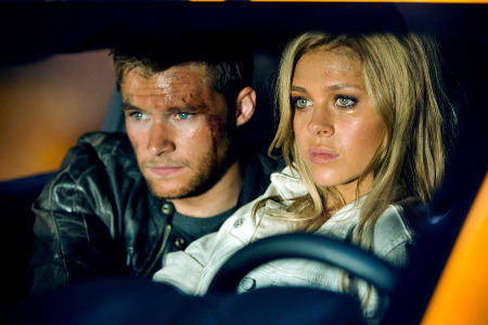 Shane (Jack Reynor) and Tessa (Nicola Peltz) hide in Bumblebee