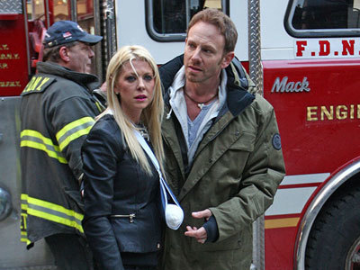 Fin (Ian Ziering) cares for an injured April (Tara Reid)