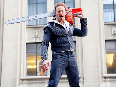 Fin (Ian Ziering) with chainsaw ready to chop sharks!