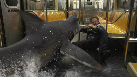 Fin (Ian Ziering) fighting shark on a train