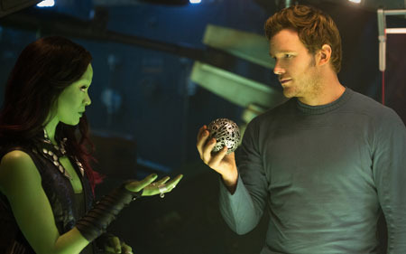 Quill (Chris Pratt) asks Gamora (Zoe Saldana) about an orb