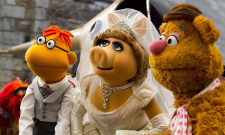 Walter, Miss Piggy and Fozzie Bear at the wedding
