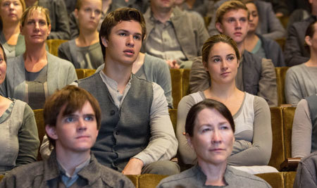Tris (Shailene Woodley) sits next to her brother (Ansel Elgort) at choosing ceremony