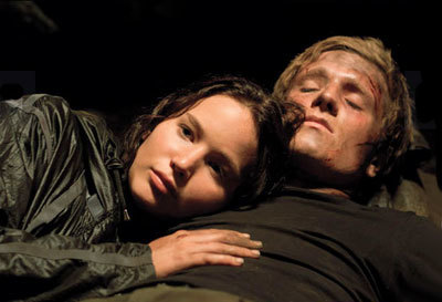 Jennifer Lawrence and Josh Hutcherson as Katniss and Peeta