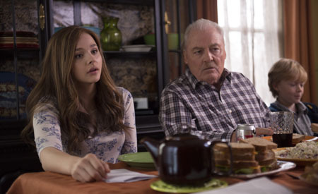 Mia (Chloë) at the dinner table with Gramps (Stacey Keach)