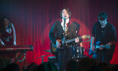Adam (Jamie Blackley) performs with his band