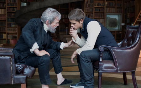 The Giver (Bridges) transfers memories to Jonas (Thwaites)