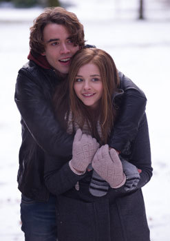 Mia and Adam cuddle in the snow