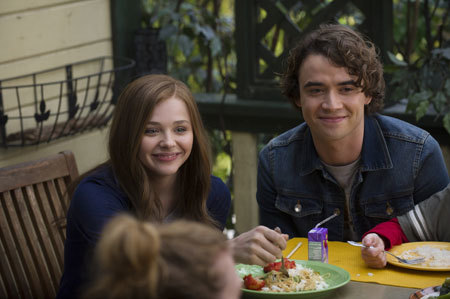 Mia and Adam (Jamie Blackley) at dinner