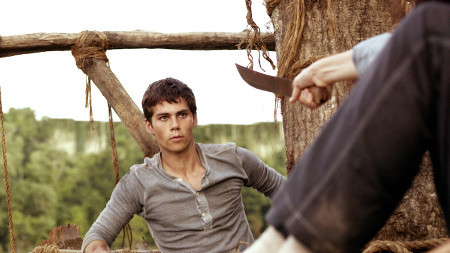 Thomas (Dylan O'Brien) meets Teresa (holding knife on him)