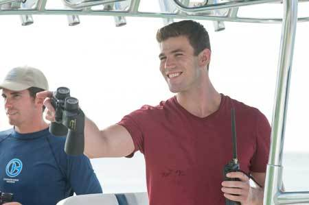 Kyle (Austin Stowell) out on the rescue/release boat