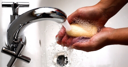 Washing your hands with just warm water and soap keeps them clean enough!