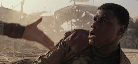 Rey offers a hand to Finn