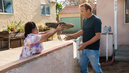 Coach White (Kevin Costner) gets a chicken as a gift