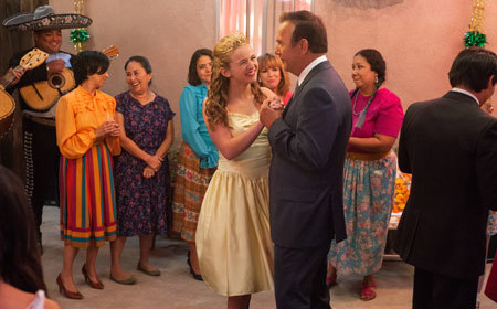 Coach (Kevin Costner) at Julie's Quinceanera party