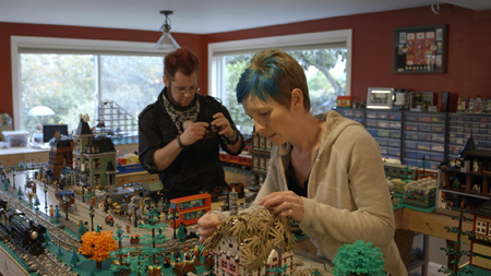 Adult LEGO fans build at home