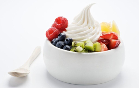 Forzen yogurt is often topped with fresh fruit
