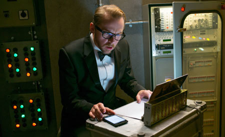 Benji (Simon Pegg) in a closet at the opera aiding Ethan Hunt
