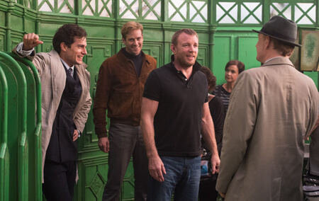 Henry and Armie on set with director Guy Ritchie