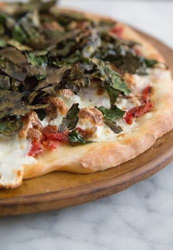 These days, you can get all kinds of pizza, including this delicious kale and sausage!