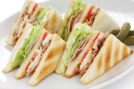 Club Sandwich: a triple-decker toasted turkey, tomato and lettuce sandwich