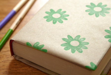 Cover books with freezer paper and design it yourself