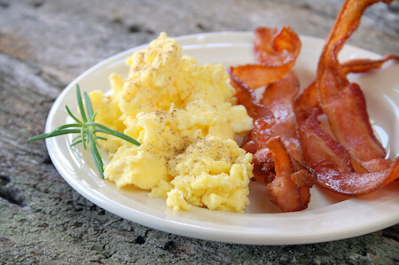 In modern North America, eggs and bacon are a staple of a full breakfast.