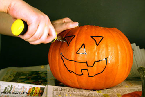 Use a stencil or draw on the pumpkin with a marker