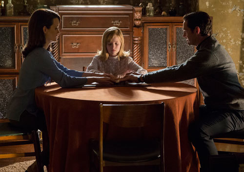 Mom Alice, Doris and Father Tom use the Ouija board