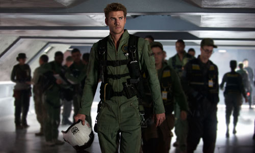 Liam Hemsworth as Jake prepares to fly a new fighter jet